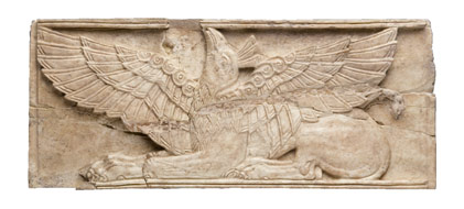 Carved ivory plaque showing a winged griffin