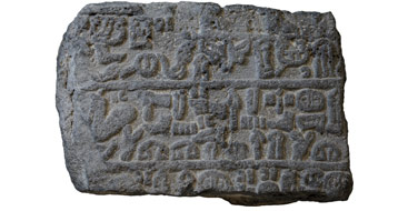 Stone fragment with Luwian hieroglyphs